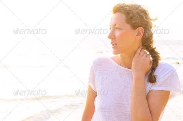 PhotoDune woman on beach at sunrise 4048045