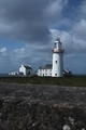 Lighthouse and sky on the irish coast - PhotoDune Item for Sale