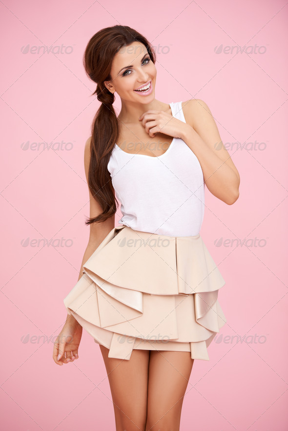 PhotoDune Cute brunette on pink 4061288