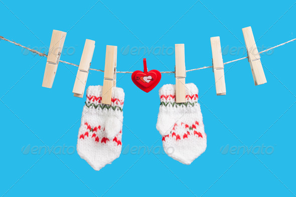 PhotoDune heart on clothesline with clothespins two mittens 4082256