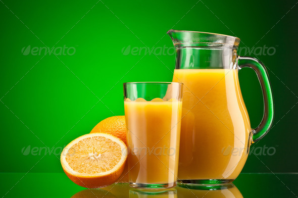 Orange juice over green - Stock Photo - Images