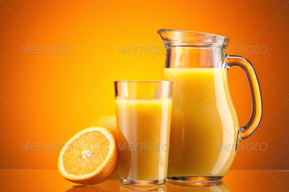 Orange juice over orange - Stock Photo - Images