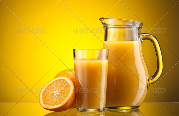 Orange juice over yellow - Stock Photo - Images
