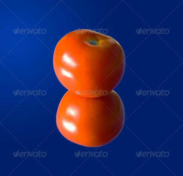 PhotoDune Tomato on a mirror 4082714