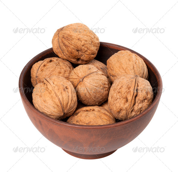 Walnuts in ceramic bowl - Stock Photo - Images