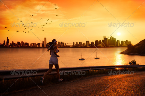 Young Woman Running At Sunset - Stock Photo - Images