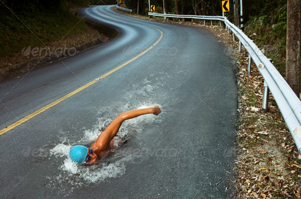 Strong Man Swim On Asphalt Road - Stock Photo - Images
