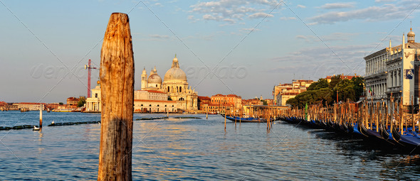 View to the gondolas and boats berth  in Venice. - Stock Photo - Images