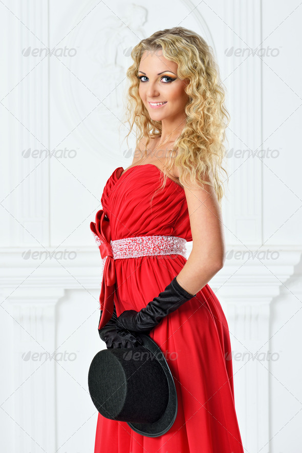 Beautiful woman in a red  dress with  hat. - Stock Photo - Images