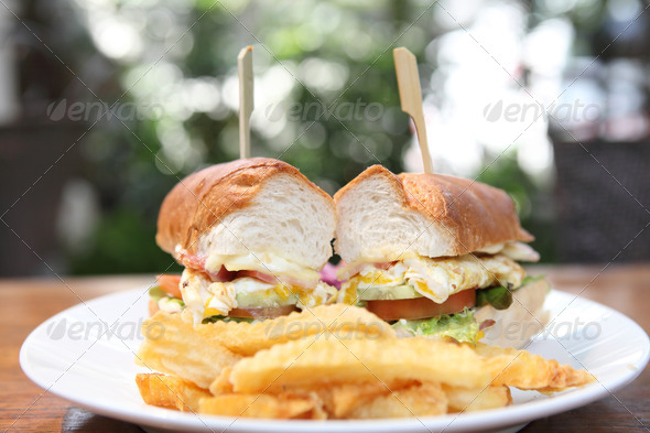 PhotoDune Club sandwich with on wood background 4152535
