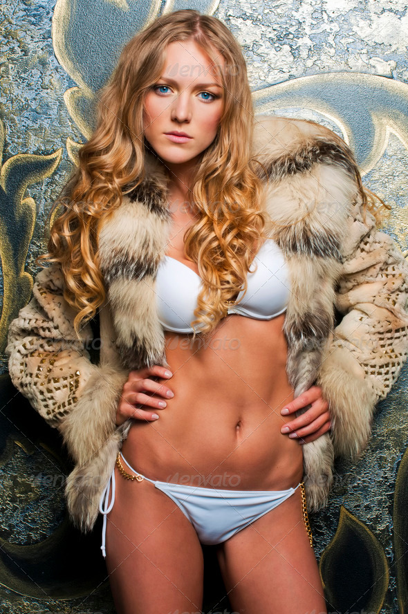 beautiful blonde in fur jacket - Stock Photo - Images