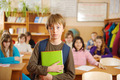 Serious schoolboy standing in front of class - PhotoDune Item for Sale