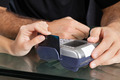 Hand Swiping Credit Card Through Terminal At Salon - PhotoDune Item for Sale