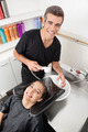Hairstylist Washing Client's Hair In Parlor - PhotoDune Item for Sale