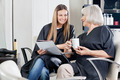 Female Client's Conversing At Beauty Parlor - PhotoDune Item for Sale
