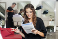 Woman With Mobile Phone Reading Magazine At Hair Salon - PhotoDune Item for Sale