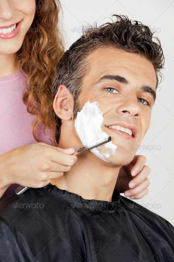 Man Getting A Shave From Barber - Stock Photo - Images