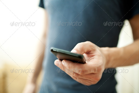 Close up of a man using mobile smart phone - Stock Photo - Images