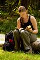 Girl reading on log - PhotoDune Item for Sale