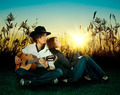 Love story. A young man playing guitar for his girl. - PhotoDune Item for Sale