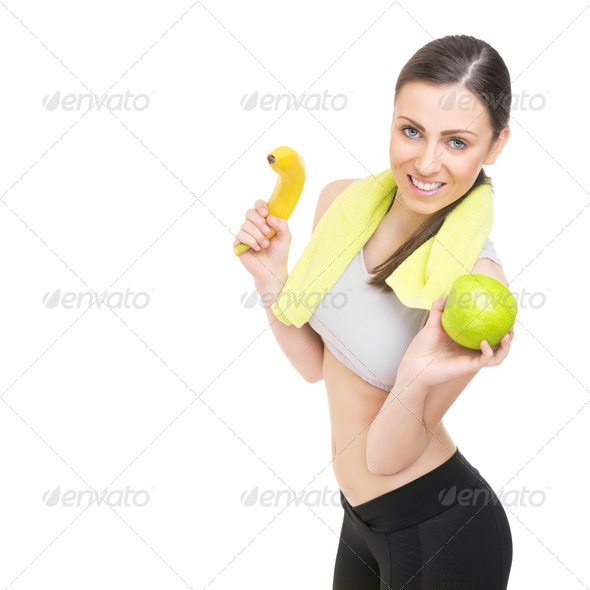 Happy fit young woman holding healthy fruits - Stock Photo - Images