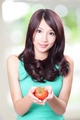 Asian woman holding fruit tomato - PhotoDune Item for Sale
