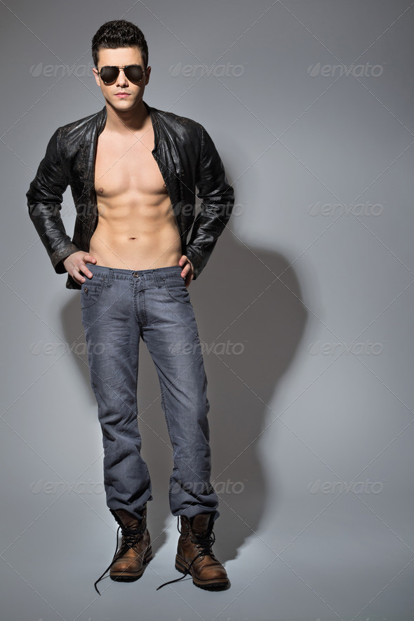 Handsome young guy wearing black leather jacket - Stock Photo - Images