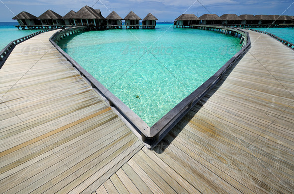 PhotoDune Beautiful beach with water bungalows 4229635