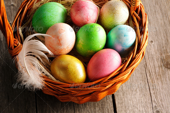 PhotoDune Colored easter eggs in basket 4229652