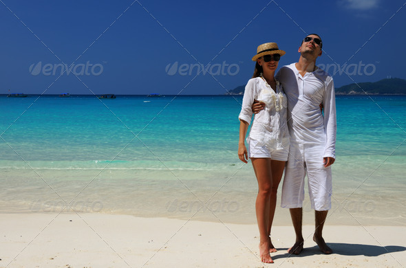 PhotoDune Couple in white on a beach 4229654