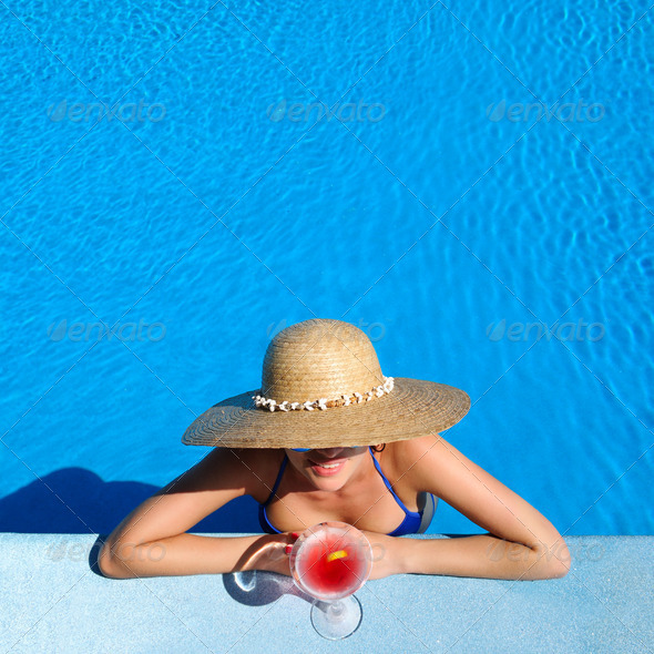 PhotoDune Woman at poolside with cosmopolitan cocktail 4229705