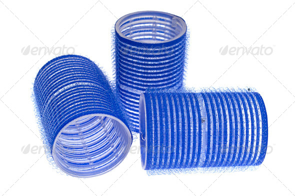 PhotoDune a few blue hair curlers on a white background 4236425