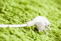 Green carpet on Power Plug Saving energy - PhotoDune Item for Sale