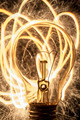 bulb and sparklers   on black background - PhotoDune Item for Sale