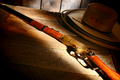 American West Legend Rifle on Cowboy Hat and Lasso - PhotoDune Item for Sale