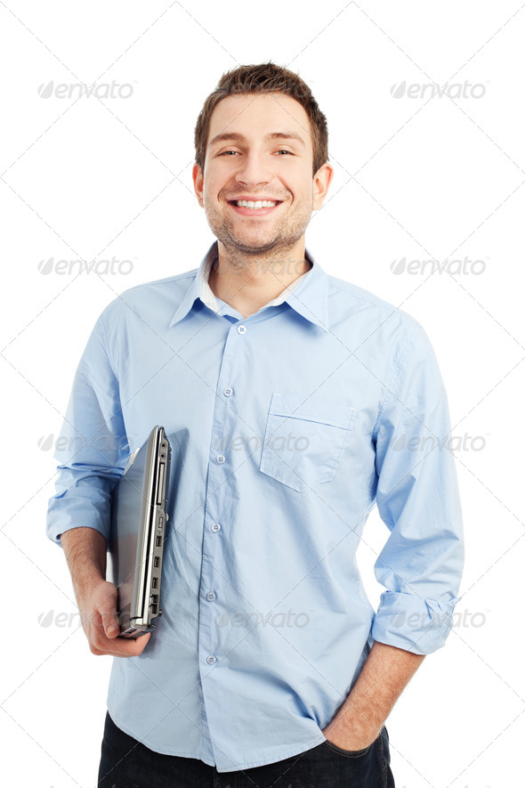 Young student with laptop smiling - Stock Photo - Images