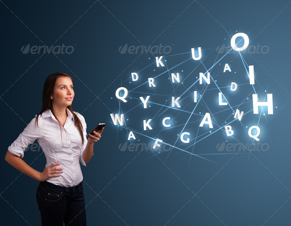 PhotoDune Young woman typing on smartphone with high tech 3D letters commi 4278485