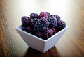 Frozen blackberries in white bowl - PhotoDune Item for Sale