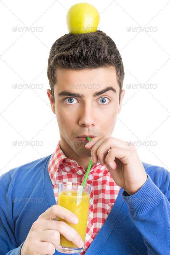Funny nerd guy drinking fresh juice with straw - Stock Photo - Images