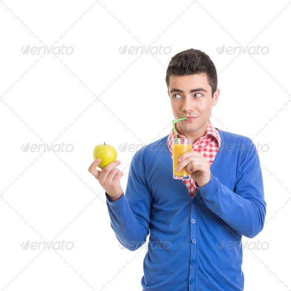 Funny young man with healthy refreshing juice - Stock Photo - Images