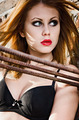 Portrait of pretty redhead girl wearing black bra. Closeup - PhotoDune Item for Sale