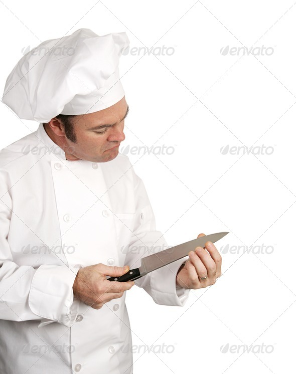 Chef Tests Blade - Stock Photo - Images