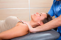 Myofascial therapy technique with therapist hands in woman - PhotoDune Item for Sale