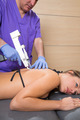 Back lumbar mesotherapy gun doctor with woman patient - PhotoDune Item for Sale