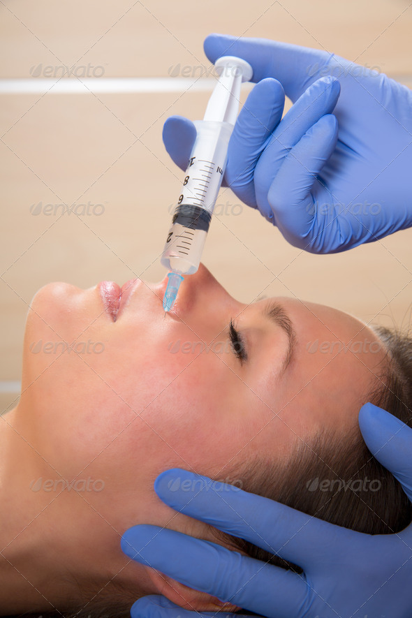 Anti aging facial mesotherapy syringe on woman face - Stock Photo - Images