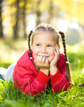 Portrait of a little girl in autumn park - PhotoDune Item for Sale