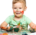 Child is grabbing some paint using fingers - PhotoDune Item for Sale