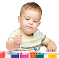 Little boy is playing with paints - PhotoDune Item for Sale
