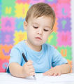 Little boy is writing on his copybook - PhotoDune Item for Sale