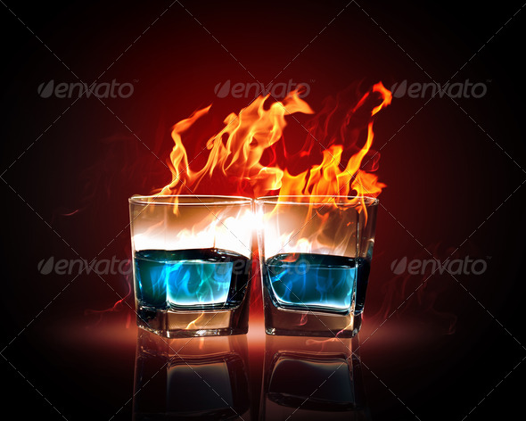 Two glasses of burning emerald absinthe - Stock Photo - Images